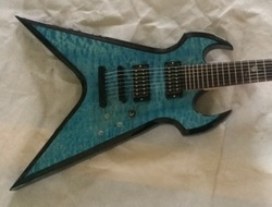 Custom Fireplant Guitars Splitsville in see-thru blue and quilted maple.